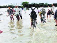 Assam flood scene still grim, life disrupted in Dibrugarh