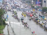 Mumbai tracks flooded, boats pull out 1,500 train passengers