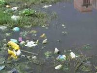Garbage heaps pile up, cause health scare